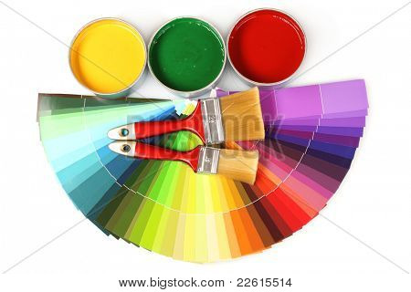 open tin cans with paint and brushes isolated on white