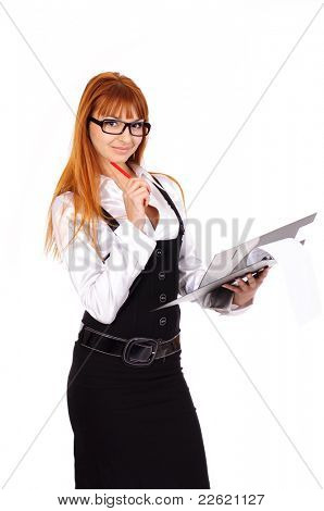 young sexy business woman with red hair with folder and red pen staying over white