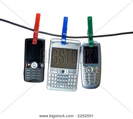Three Mobile Phones On A Clothes Line