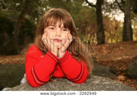 Smug Young Girl   Outdoors On A Rock