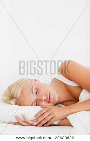 Portrait of a woman sleeping in her bedroom