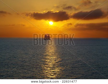 Sailing at sea sunset .