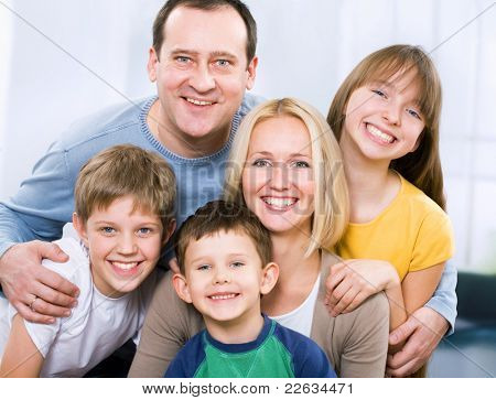 Happy family smiling looking at camera