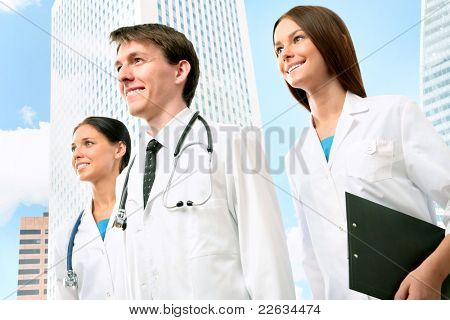 Young physicians on the background of a modern medical center