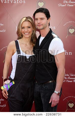 LOS ANGELES - MAR 13:  Kadee Strickland, Jason Behr arriving at the John Varvatos 8th Annual Stuart House Benefit at John Varvaots Store on March 13, 2011 in Los Angeles, CA