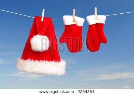Santa'S Hat And Gloves Drying
