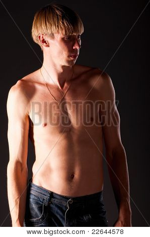man is standing on black background