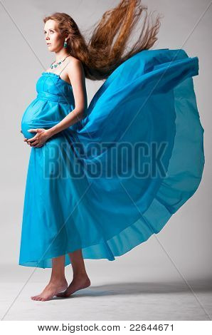 pregnant woman with flying dress