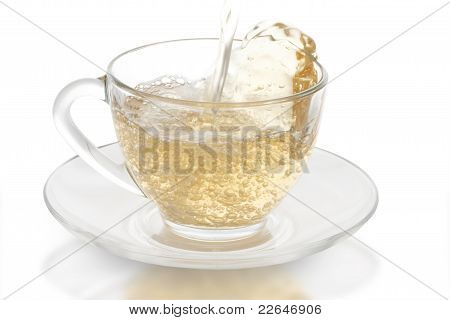 Green Tea Pouring Into Glass Cup