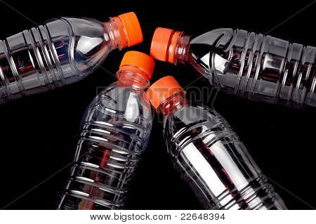 Four Closed Plastic Bottles