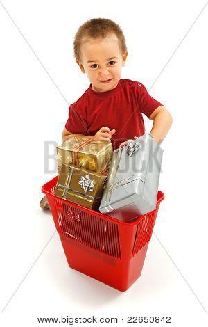 Little Boy Throwing Presents In Garbage Bin