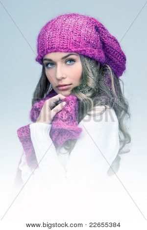 blue-toned picture of beautiful woman in winter hat