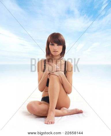 Sexy lady isolated over abstract resort background
