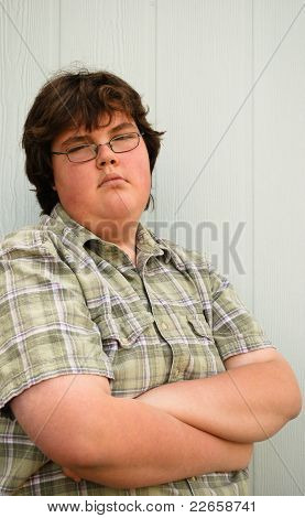Teen-aged Boy with folded arms
