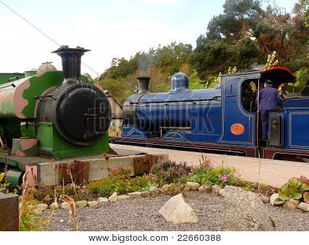 steam train at platform with driver