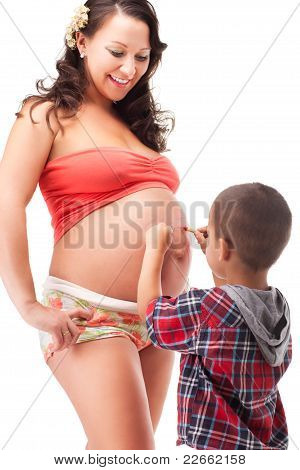 Pregnant woman and a little boy