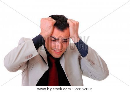 Portrait of a tensed young business man with hand on the face