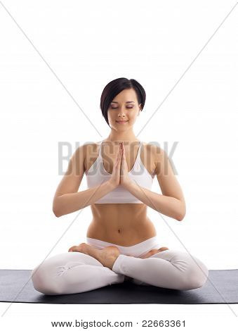 woman sit in yoga pose - lotos on rubber mat