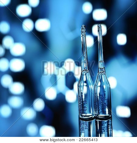 ampoule on abstract bokeh background