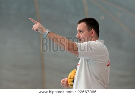 KAPOSVAR, HUNGARY - APRIL 2: Mark Horvath (referee) in action at a Hungarian national championship water-polo game between Kaposvari VK (white) and AVSE (blue) on April 2, 2011 in Kaposvar, Hungary