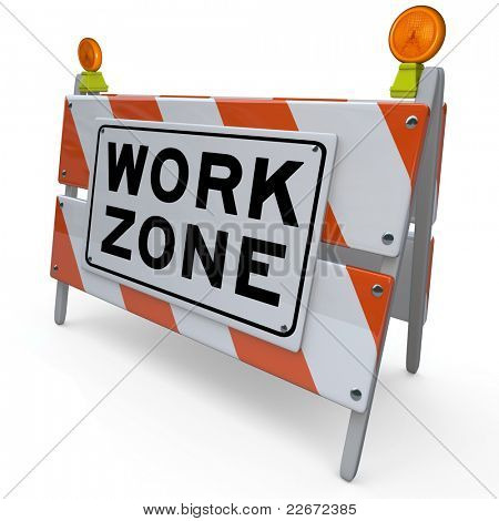An orange and white construction barricade sign blocking an area that is a designated work zone where workers are improving a road, sidewalk or other public transportation feature