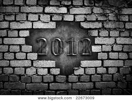 "cracked wall with ""2012"" carving"