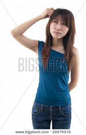 Cute Asian girl thinking hard, scratching head and looking up on white background.