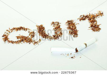 broken cigarette with word quit