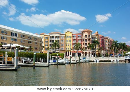 Colorful Tropical Buildings Overlooking Water And Piers