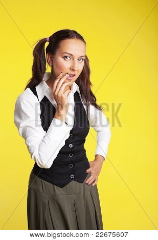 Beauty woman posing school-girl with cigarette