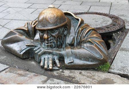 Man At Work Sculpture