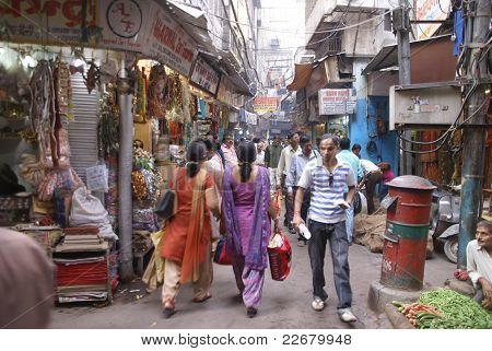 Indian Women In Colorful Saris Browse The Market Stores