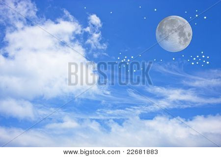 Blue Cloudy Sky With Full Moon