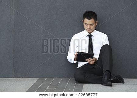 Asian Business man using an ipad