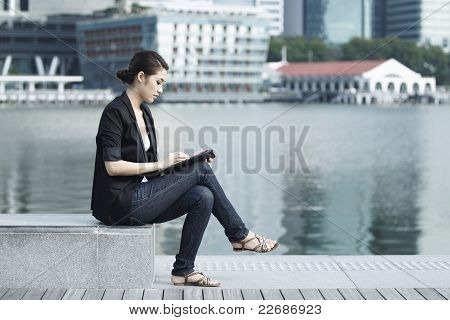 Business Woman Using An Ipad