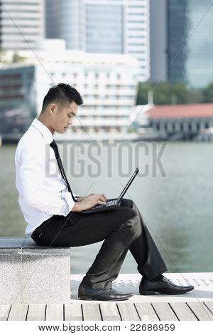 Asian Business Man Using An Ipad