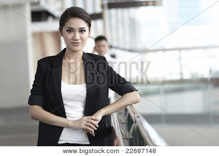 Business Woman With Colleague In The Background