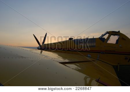 Crop Duster At Sunset