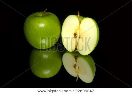 Green Apples On The Black Background