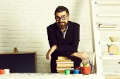 Teacher Student, Happy Bearded Young Guy In School Or Classroom With Books On Desktop In September B poster