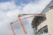 picture of cherry-picker  - Two High Lift Cherry Picker Platforms on a Construction Site - JPG