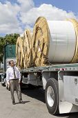 stock photo of 18 wheeler  - Truck bringing a load of Fiber - JPG