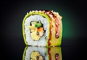 Sushi rolls japanese food over black background. Sushi roll with salmon, tofu, vegetables and avocad poster
