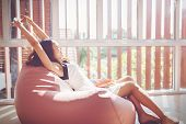 Young Asian Woman Relaxing On A Sofa At Home And Drinking Coffee Of The Living Room.relaxing,happy C poster