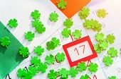 St Patricks Day Festive Background. Green Quatrefoils And Irish Flag Covering The Calendar With Fra poster