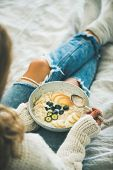 Healthy Winter Breakfast In Bed. Woman In Woolen Sweater And Shabby Jeans Eating Vegan Almond Milk O poster