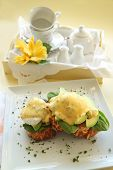 picture of benediction  - Beautiful eggs benedict with bacon and a rich hollandaise sauce on tiger crust bread - JPG