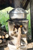 Thai Cooking Style, Steam Pot On Vintage Local Fire-stove In Kitchen Of Old Wooden House, Thai Stove poster