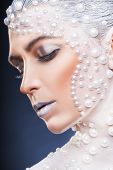 Fantasy Make-up. Portrait Of Beautiful Woman With Fantasy Make-up With White Pearls On A Dark Backgr poster