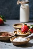 Ingredients For Cooking Chocolate Mug Cakes. Flour, Cocoa Powder, Sugar, Caramel In Wooden Bowls, Mi poster